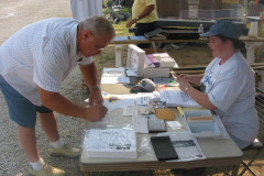 A new FENA member signing up with Sarah Weaver.