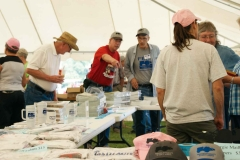 shoopers and items for sale in the FENA tent