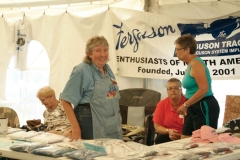 FENA Furrows Editor Judy Kitson and others helping with sales of FENA items