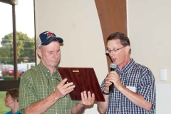Steve Bieberich accepts the Clarence Carhill award from outgoing President Brent Holloway