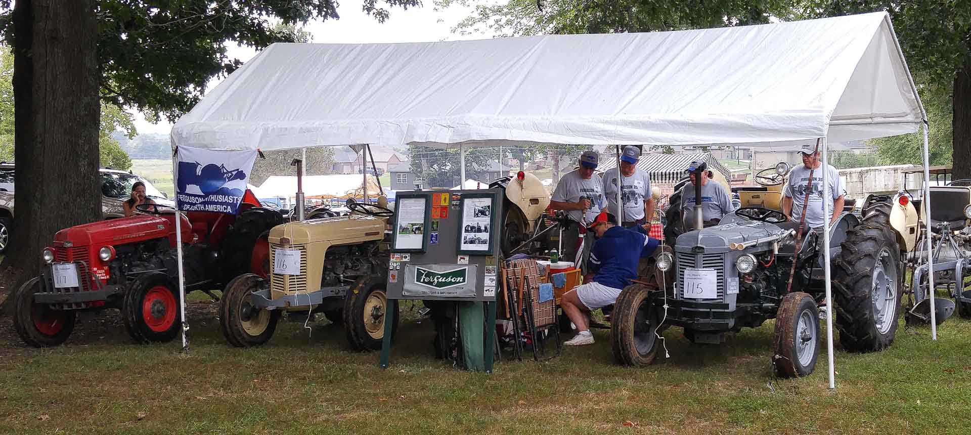 The Sprague's tent with their tractors. The one on the right had hand controls added and place to put crutches. Hand controls outfitted for their father Paul Jr. who had polio.