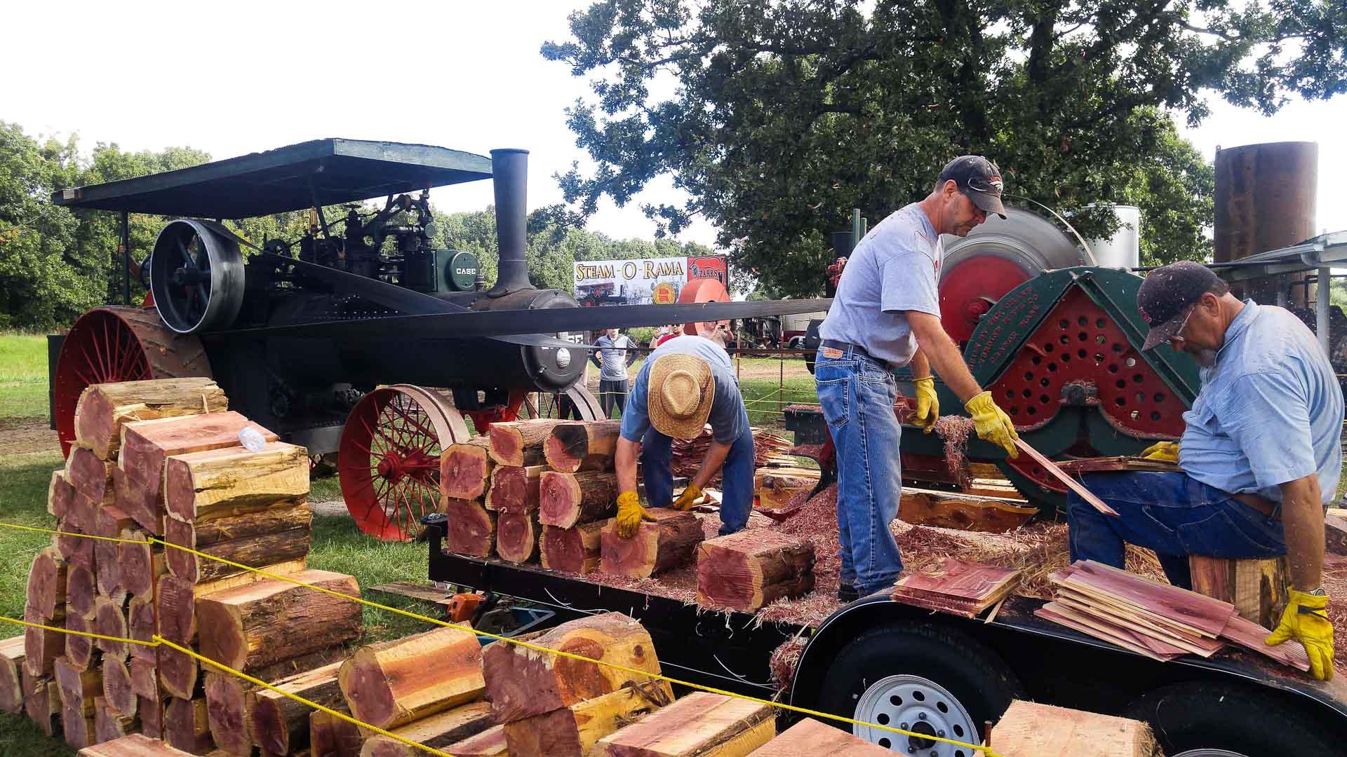 The Ozark Steam Engine Association cutting cedar shingles using a steam tractor.