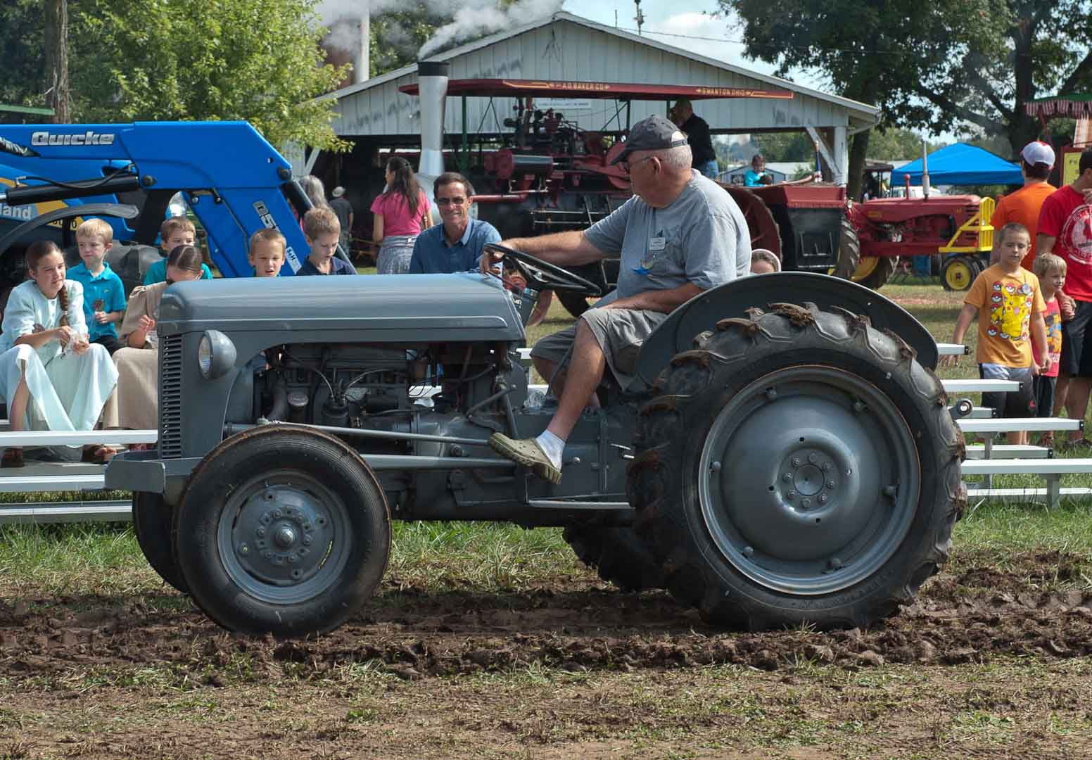 Norman Fleagle of Indianola, IA in the tractor parade. TO 20 or 30.