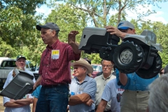 "Steve Bieberich and Brent Holoway holding up the Gratass ""The Little Grey Fergie"" Pedal Tractor."
