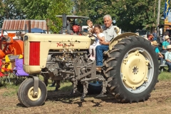 Mickey Keener from Pattonville, TX with his granddaughter Amelia on F40 with cultivator.