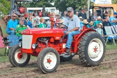Mike Etzel of Marion, IA riding his BMC Model 425 Mini – the last tractor built in Coventry – the last Harry Ferguson design off the assembly line.