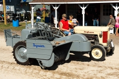 Jim Folkerts driving his 1957 F-40 Utility with side-mounted baler