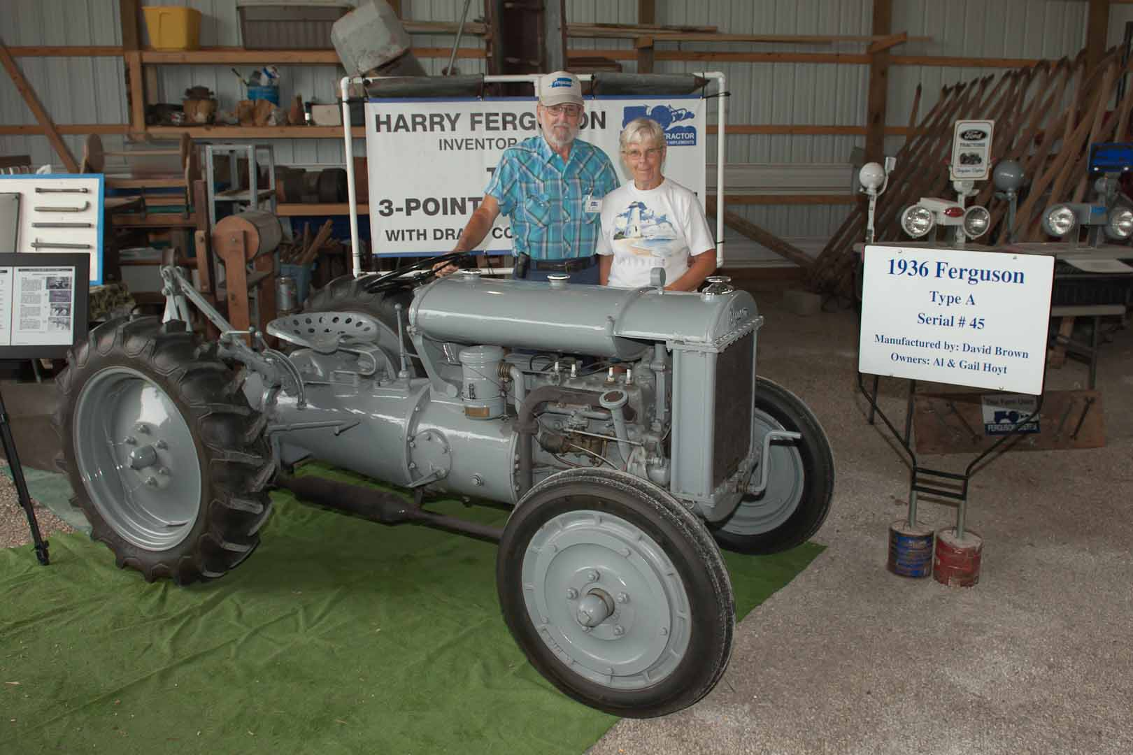 1936 Ferguson-Brown Model A SN 45 owned by Al Hoyt of Center Hill, FL.  Implement is a ten inch two bottom plow.  Al and Gail are pictured.