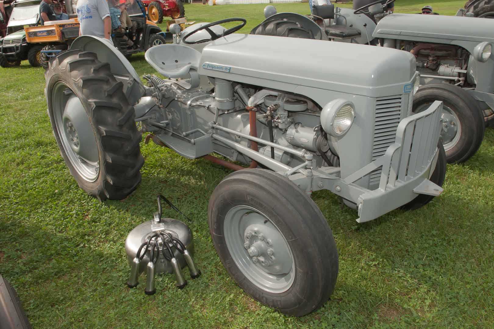 1951 TO-30 SN TO-62612 owned by Megan Kimball and Grandpa Richard of West Liberty, OH.  Vacuum-driven milker sitting next to the tractor.
