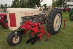 1957 F-40 SN TGM405675 owned by Mickey Keener of Pattonville, TX.  Note the single front wheel.  Implement is a 1957 MHF Mid-Mount Cultivator and rear cultivator.